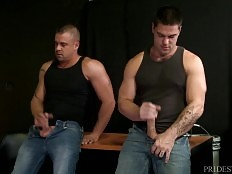 Sean bends them both over so he can get his tongue deep in their asses and he goes back and forth rimming them deep. After rimming Sean wants to be fucked by both of them and they both fuck him until he cums all over himself and then they blow their loads